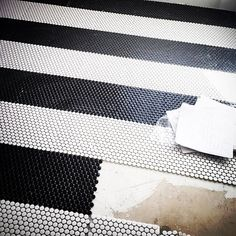 black and white Striped penny tiles on a laundry floor