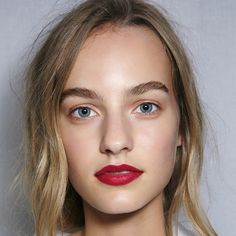 Red lipstick is an empowering look for both day and night.  Try this fresh twist on the look by keeping the rest of your make-up low key, and smudging a cherry coloured lippy into your lips with a finger. Seen at: Burberry Spring/Summer 2015