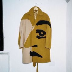 illustrated face coat | see more on tumblr (@fuggiamo)