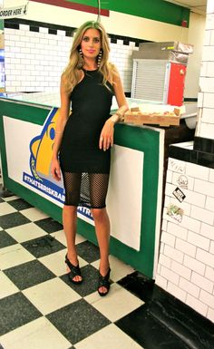 This dress is a size Small and will fit a 0, 2, 4. We are calling this favorite Revolve Clothing designer Donna Mizani dress a fishnet dress for obvious reasons. What might not be obvious is how well this dress stretches for the occasional late-night pizza binge. Paired with Oscar de la Renta tassel clip-on earrings and a Jumbo Slice of pepperoni 'za.