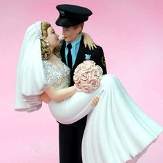 Cute cake topper for policeman. (we would obviously do air force :)