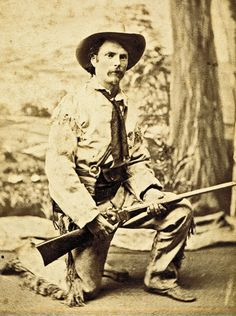 """Garbed in a fringed buckskin costume this """"western"""" poser grasps what appears to be a percussion Sharps New Model 1863 straight-breech carbine without a patchbox. The ignition system, outmoded at the time the photograph was taken circa 1885-95, suggests that the gun most likely served as a studio prop. – Courtesy Dickinson Research Center, National Cowboy & Western Heritage Museum, 2003.111 –"""