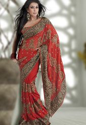 Todays fashionable colors are just oozing to expel your beauty within, positive results are guaranteed after you have boosted your confidence into looking beautiful with the latest in fashion styles. Style and trend will be at the peak of your beauty when you drape this tango orange faux georgette saree. Beautified with resham, zari, stone, beads, cutdana and patch work all synchronized well with the pattern and design of the attire. The border of this saree is a symbol of elegance in its…