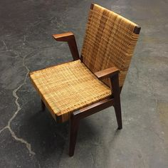 Arden Riddle; Walnut and Cane Armchair, 1970.