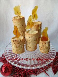 Con questa ricetta ho cercato di realizzare al meglio un'idea vista in una rivista con la pasta frolla ,la crema pasticcera e fiamme di caramello...La cucina di ASI