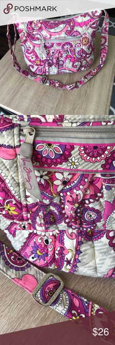 "Large Vera Bradley Cross Body Large VB cross body satchel in fun ""paisley meets plaid"" pattern.  This bag has a light grey plaid background plus a pink and purple paisley design over the top.  This bag features an exterior zip pocket and four interior slip pockets.  It measures approximately 10 x 14 x 4 inches and has an adjustable cross body strap.  Gently used; pilling evident on zipper pull (see pictures).  Stored in smoke and pet free home. Vera Bradley Bags Crossbody Bags"