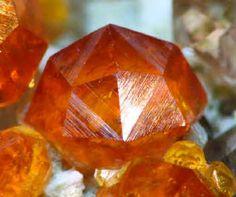Spessartine Garnet Crystals on Microcline