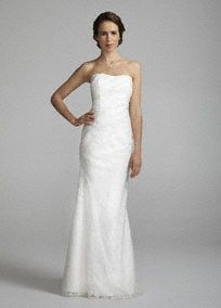 Elegant and chic, this modern twist on a classic silhouette is sure to wow any crowd! Strapless bodice features soft and airy linen burnout fabric perfect for an out-door wedding. Fit and flare skirt adds a touch of drama and class to this already beautiful gown. Available in Ivory. Fully lined. Back zip. Imported polyester. Dry clean.A popular neckline for brides seeking a stylish and versatile look (offering unlimited jewelry and accessory options).Chiffon or organza based fabric that has…