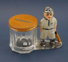 """painted glass figure with bat and incised """"P"""" on cap and chest standing next to a pressed glass container with tin co. on Dec 2014 Sports Toys, Candy Containers, Glass Candy, Baby Rattle, Baseball Players, Charms, Collections, History, Antiques"""