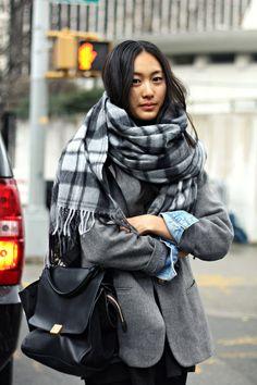 Plaid scarf, blazer, denim cuffs.