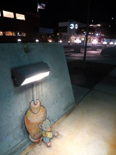 Mouse reading a book under a street light in trompe l'oeil chalk street at by David Zinn