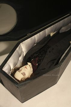 Vampire - Articulated dolls  Handmade Victorian costuming, leather boots, glass eyes, sheepskin wigs, and satin lined wooden coffins.