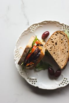 Vegan roasted eggplant sandwich with hummus and harissa relish. Made with Mina harissa. Simple, quick and easy for lunch or on the go.