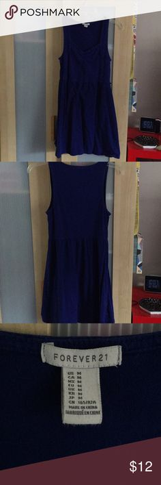 A royal blue dress with belt. I will put the belt that accompanies a dress in the box with purchase. I have worn the dress before. fits more like a mini now. Forever 21 Dresses Mini