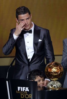 Real Madrid's Portuguese forward Cristiano Ronaldo cries after receiving the 2013 FIFA Ballon d'Or award for player of the year during the FIFA Ballon d'Or award ceremony at the Kongresshaus in Zurich.