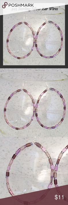 """Lavender, Plum & .925 SS Beaded Boho Hoop Earrings These large teardrop hoop earrings are made with a beautiful selection of lavender and plum shimmering and iridescent glass seed beads. They measure 3 1/2"""" including the ear wire. The ear wire is .925 sterling silver while the hoops & connector rings are silver-plated. Very lightweight. Handcrafted by me. Fantastic boho chic style!   Jewelry items are priced firm as a single purchase due to material cost & Poshmark fees. Why not BUNDLE for a…"""