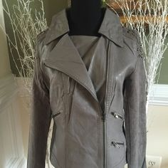 Gray studded imitation leather jacket This great looking jacket has faux suede sleeves and zippers galore! I have 2 small, 2 medium and 1 large.. Comment with your size and I will make you a separate listing.. Monoreno Jackets & Coats