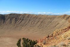 Looking into the Barringer Meteor Crater in the Arizona desert on a beautiful sunny day. Image captured by Nicole.