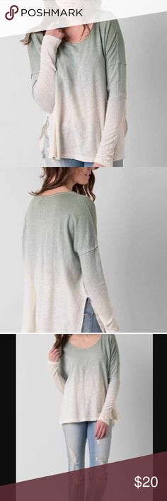 Free People Long Sleeve Tee •minimal wear •some piling under arms •no signs of stains or rips •last picture shows darker color stitching on the back of shirt. Was purchased this way 🌻NO TRADES 🌻OFFERS WELCOMED! 🌻BUNDLE TO SAVE  🌻FEEL FREE TO ASK ANY QUESTIONS Free People Tops Tees - Long Sleeve