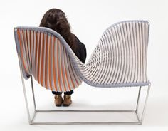 The Stretch Lounge by Michelle Dunbar evolves through use. When people are sitting in it, the lounge stretches, and hidden colors are revealed through the knitted textile. It is made for two people to sit in it, creating an interaction between the seated and the chair itself.