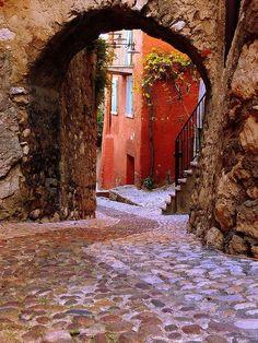 Cobblestone back street in Malcesine, Veneto, Italy
