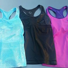 3 Nike Dri-Fit Tanks All in excellent condition (black has some threading flaws). Size Large. Built in Bras. Nike Tops Tank Tops