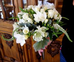 White wedding bouquet of veronica, freesia, roses and mint by Design Works floral studio in Colorado Springs, CO