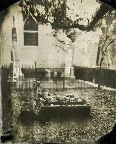 """A tintype of tokens left by Old Burying Ground visitors, on the grave of the """"little girl buried in rum keg."""""""