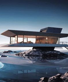 Amazing concrete, glass, and steel home, suspended above a beach. Appears to get it's feet wet at high tide. Also appears to be a really good rendering, not a photon. Still searching for more info.