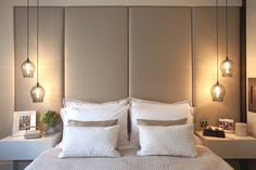 Love this.....stunning lights and the big headboard looks fab too!!