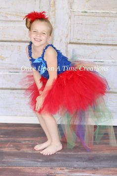 Hey, I found this really awesome Etsy listing at https://www.etsy.com/listing/186374814/scarlet-macaw-feather-bustle-tutu-girls