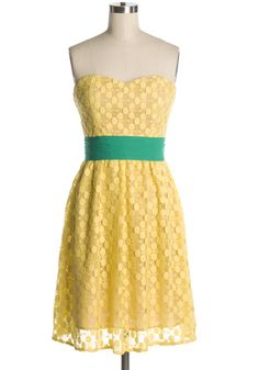 bright yellow lace dress with kelly green sash