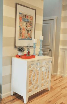 sherwin williams canvas tan is one of the best beige neutral paint colours. Shown here with Dover White stripes