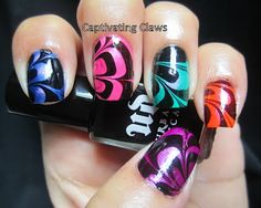 this is clever - she painted each nail a diff color then just marbled black & clear over