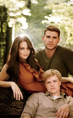I wish they had gotten someone cuter to play Peeta....sigh.    Lawrence, Hutcherson, and Hemsworth pose in the North Carolina woods. Growing up, Katniss and Gale would often risk their lives by crawling beneath the electric fence encircling District 12 to hunt in the forest. She would use the skills learned on these excursions to keep both Peeta and herself alive in the deadly arena.