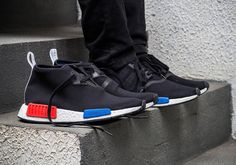 http://www.nmdtrainers.co.uk/adidas-nmd-r1-nmd-black-with-red-and-blue.htm
