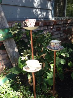 My refurbished tea cups. Kind of pretty in the front yard by our welcome sign