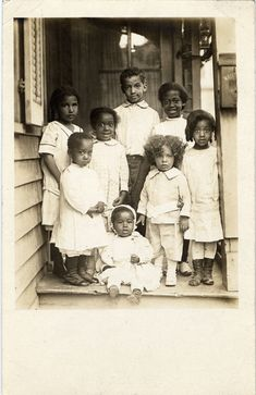 """detroitlib: """"  Postcard of eight unidentified African American children posing on the porch. Stamped on back: """"Harvey C. Jackson photographer 474 Beaubien St., Detroit."""" • Courtesy of the Burton Historical Collection, Detroit Public Library """""""
