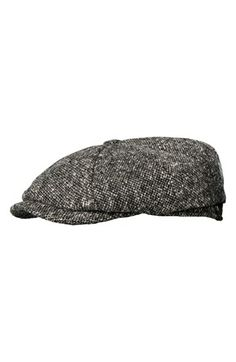 Tweed driving cap for a classic and stylish holiday look.
