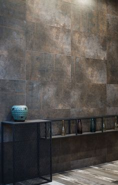 The Sheffield range of porcelain wall & floor tiles has a cool and modern look - resembling distressed and rusted metal panels Splash back idea