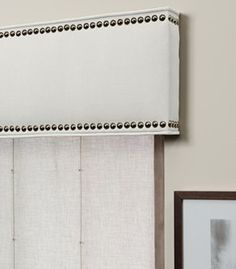 simple nailhead cornice for dining room..with a colored linen fabric
