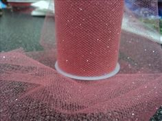 6 inch by 10 yard GLITTER TULLE -  Coral. $3.00, via Etsy.