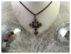 A personal favorite from my Etsy shop https://www.etsy.com/listing/171839496/cross-pendant-on-antique-brass-tone