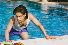 American singer and musician Prince, real name Prince Rogers Nelson poses in a swimming pool for a photoshoot with photographer Steve Parke in June 1999.