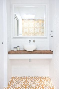 Love this small bathroom design with floating white counter topped with unfinished reclaimed wood counter top, small white basin sink, wall-mounted silver sink faucet, and gorgeous dark yellow, tan…More Interior Design Minimalist, Minimalist Decor, Decor Interior Design, Interior Decorating, Modern Minimalist, Decorating Ideas, Interior Colors, Decorating Kitchen, Interior Modern