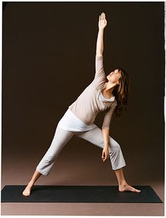 Triangle strengthens your entire body. Stand with your feet farther than shoulder-width apart. Face your right toes forward and left toes out. Bend your left leg, placing your left hand on the thigh, eyes looking down (as shown in previous slide).[A] Inhale, then exhale as you lift your right arm above your shoulder and turn your head, eyes looking up. Place your left arm on your thigh for support (this slide).[B]Hold for 1 full breath as you lower your right arm and straighten leg. Return…