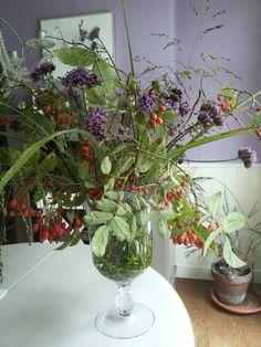 Fall arrangement.  Rose hips, verbena bonariensis, fountain grass (panicum), miscanthus 'zebrinus', privet berries (ligustrum ovalifolium)