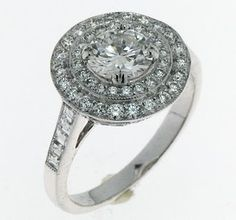 Art deco inspired engagement ring. Double halo set in white gold. S.T. Kluh Jewelers