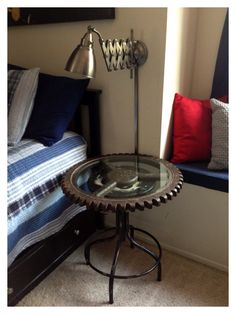 Garage or cars theme boys room. Made the end table from a Route 66 stool and a gear wheel tabletop. Garage Room, Gear Wheels, Guest Room Decor, Car Themes, Parade Of Homes, Disney Cars, End Tables, Diy Furniture, Baby Kids