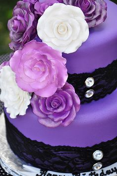 I love the purple color and the fun black lace around the tiers. Way cute!